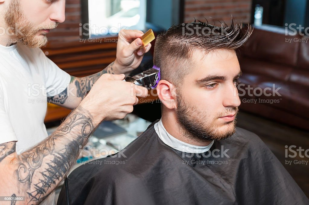 Young man having hair cutted stock photo