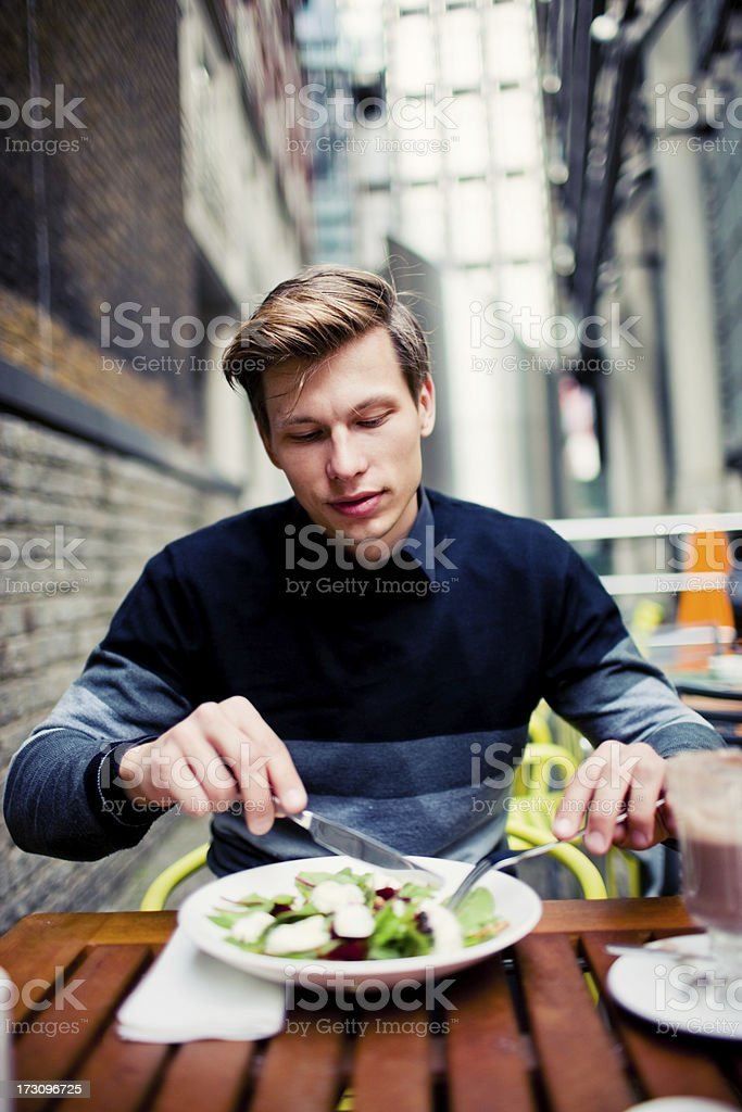 Young Man Having Healthy Lunch in Outdoor Cafe stock photo