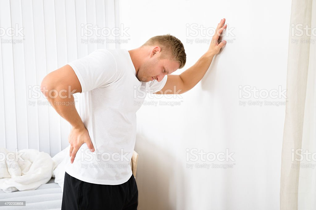 Young Man Having Pain In His Back stock photo