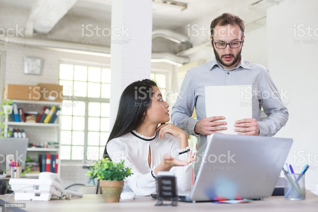 Young man having problems at the office stock photo