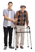 Young man helping a mature man with a walker