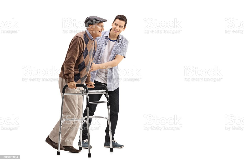 Young man helping an elderly man with a walker stock photo
