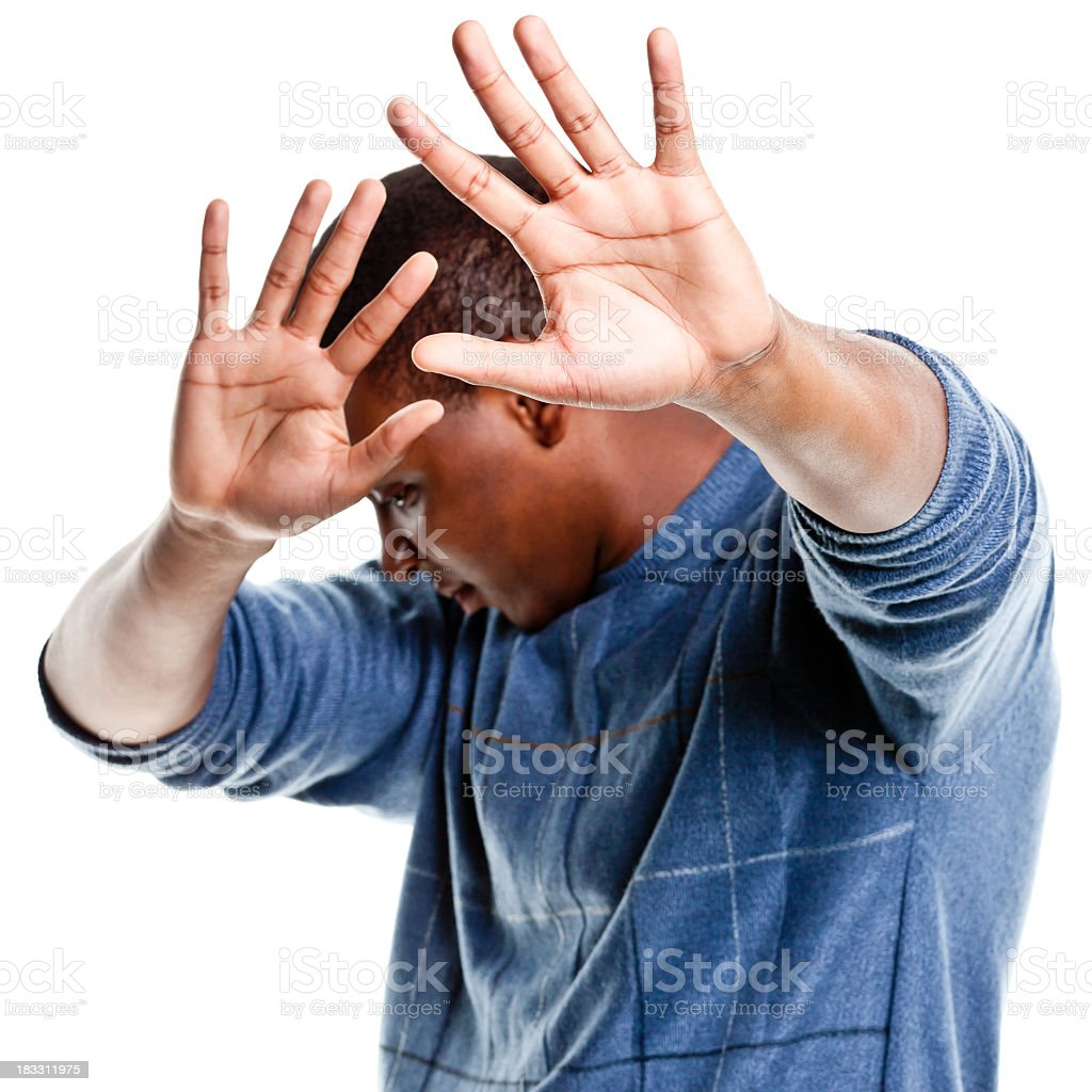 Young Man Hiding From the Camera stock photo