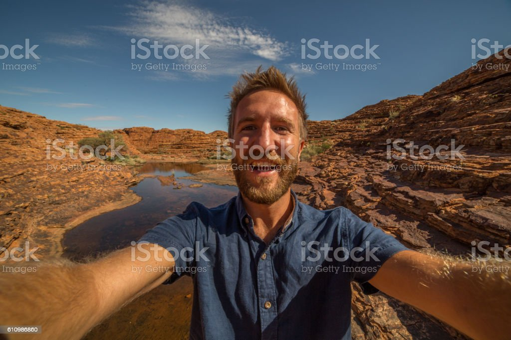 Young man hiking in Australia take selfie portrait with landscape stock photo