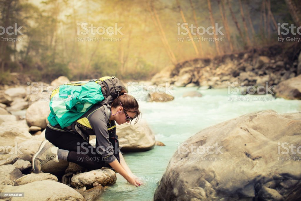 Young man hiking in nature by the river stock photo