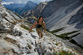 young man hiking in scenic mountain landscape of Dolomite Alps