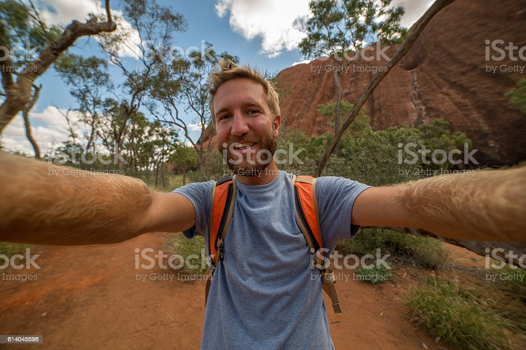 Young man hiking in the Australian outback takes selfie stock photo