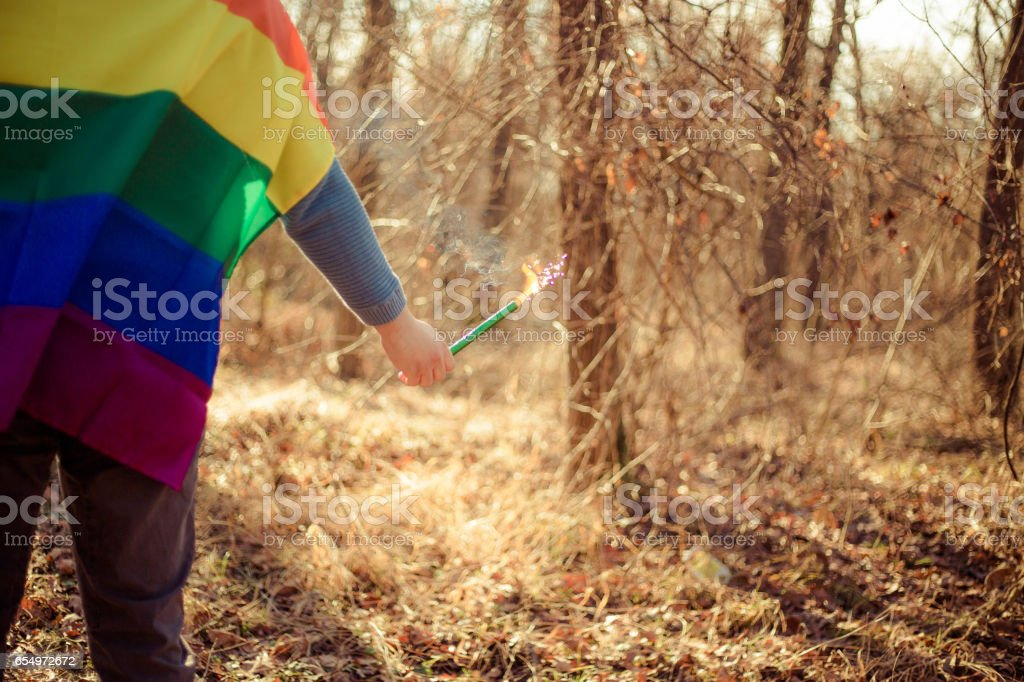Young man hold a rainbow flag guy boy stock photo