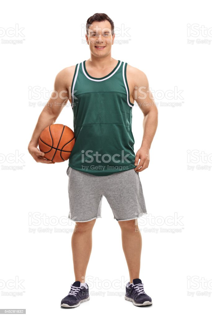 Young man holding a basketball stock photo