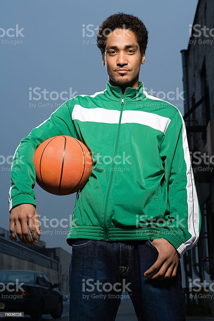 Young man holding a basketball royalty-free stock photo