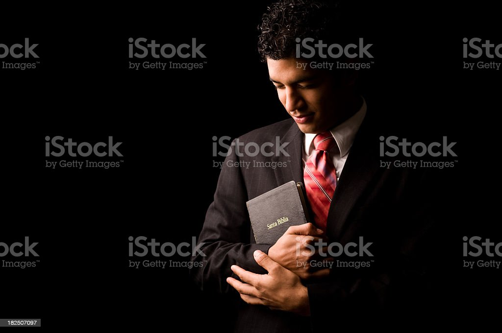 Young man holding a Bible royalty-free stock photo