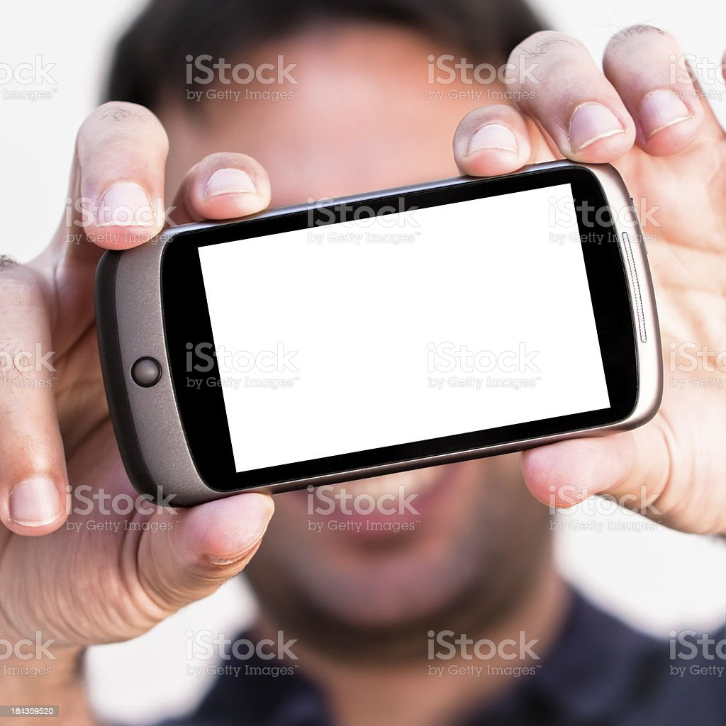 Young Man Holding a Blank Screen Smartphone royalty-free stock photo