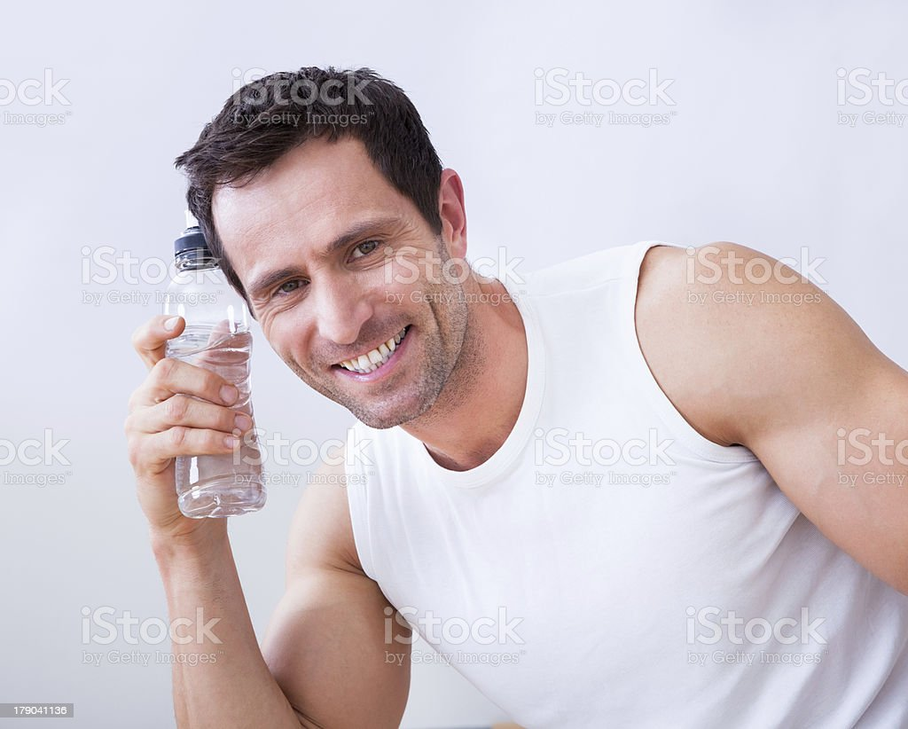 Young Man Holding A Bottle Of Water royalty-free stock photo