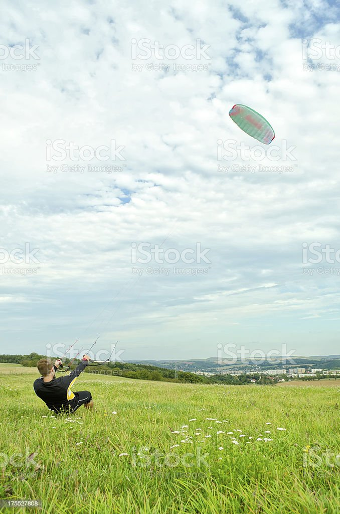 Young man holding a kite stock photo