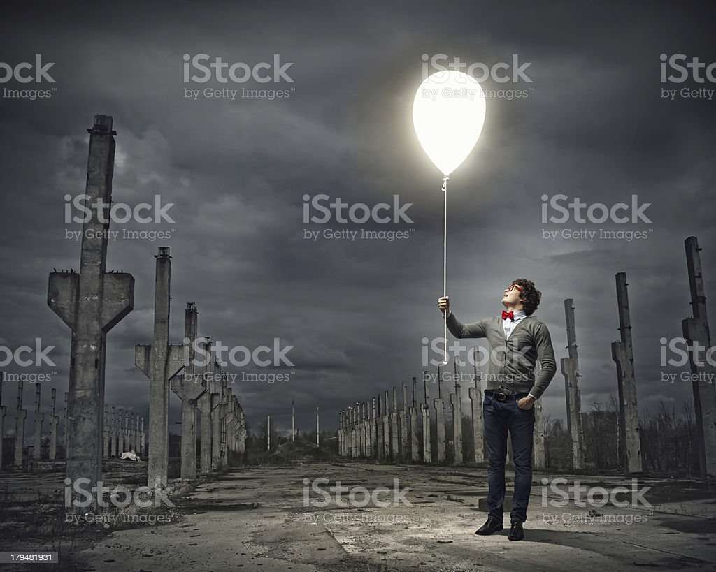 Young man holding a light royalty-free stock photo