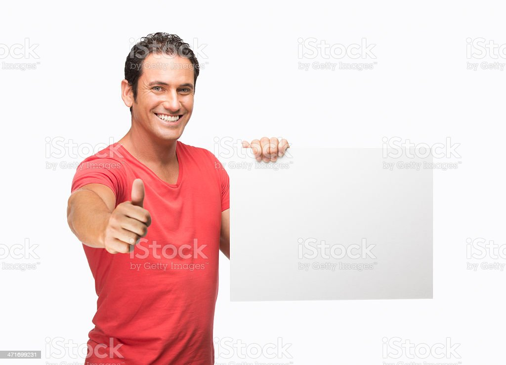 Young man holding a sign and making thumbs up royalty-free stock photo