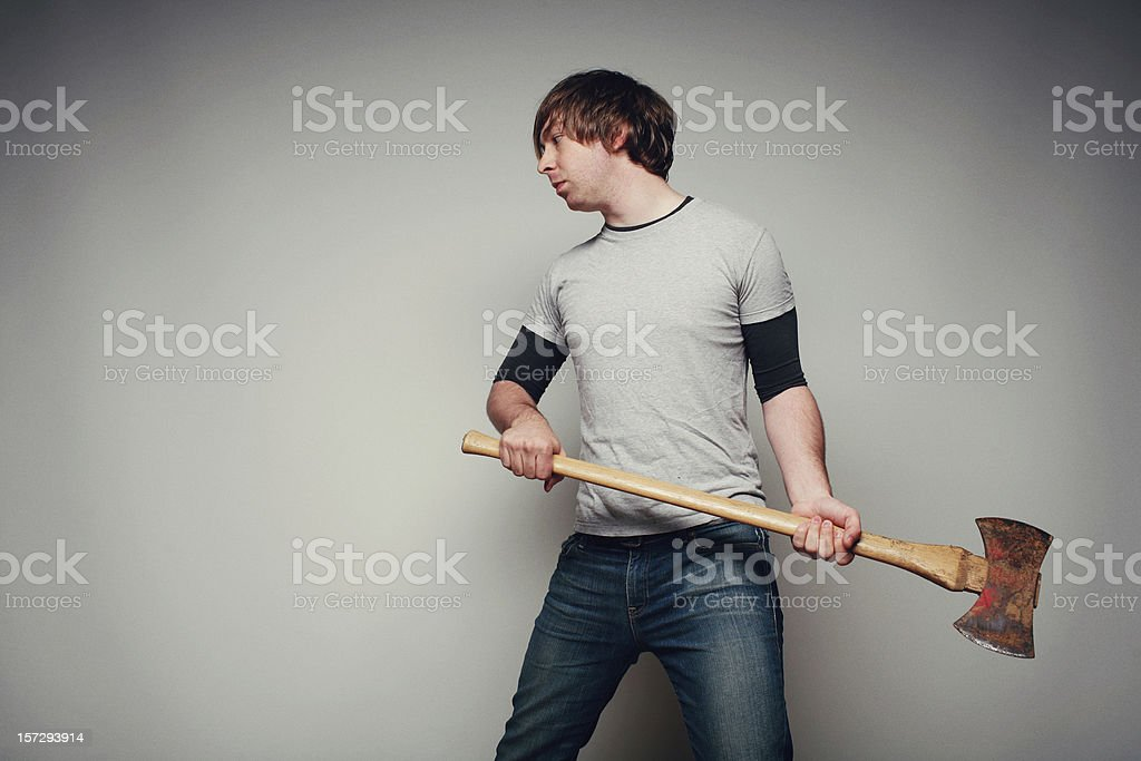 Young Man Holding an Ax royalty-free stock photo