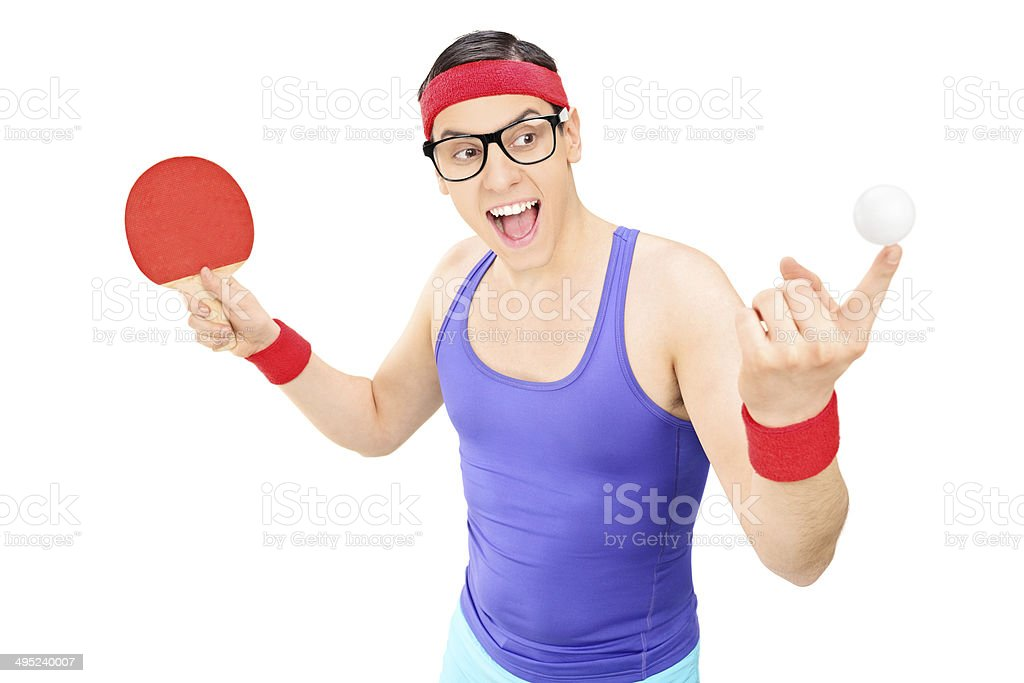 Young man holding ball and a ping pong bat stock photo
