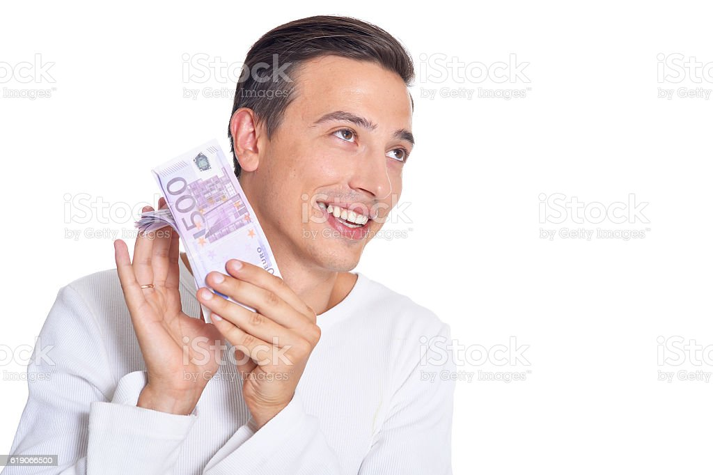 young man holding bills stock photo