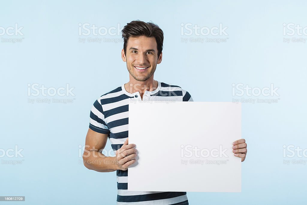 Young man holding blank banner sign stock photo