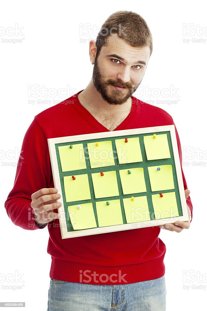 Young man holding Bulletin Board  with post it stock photo