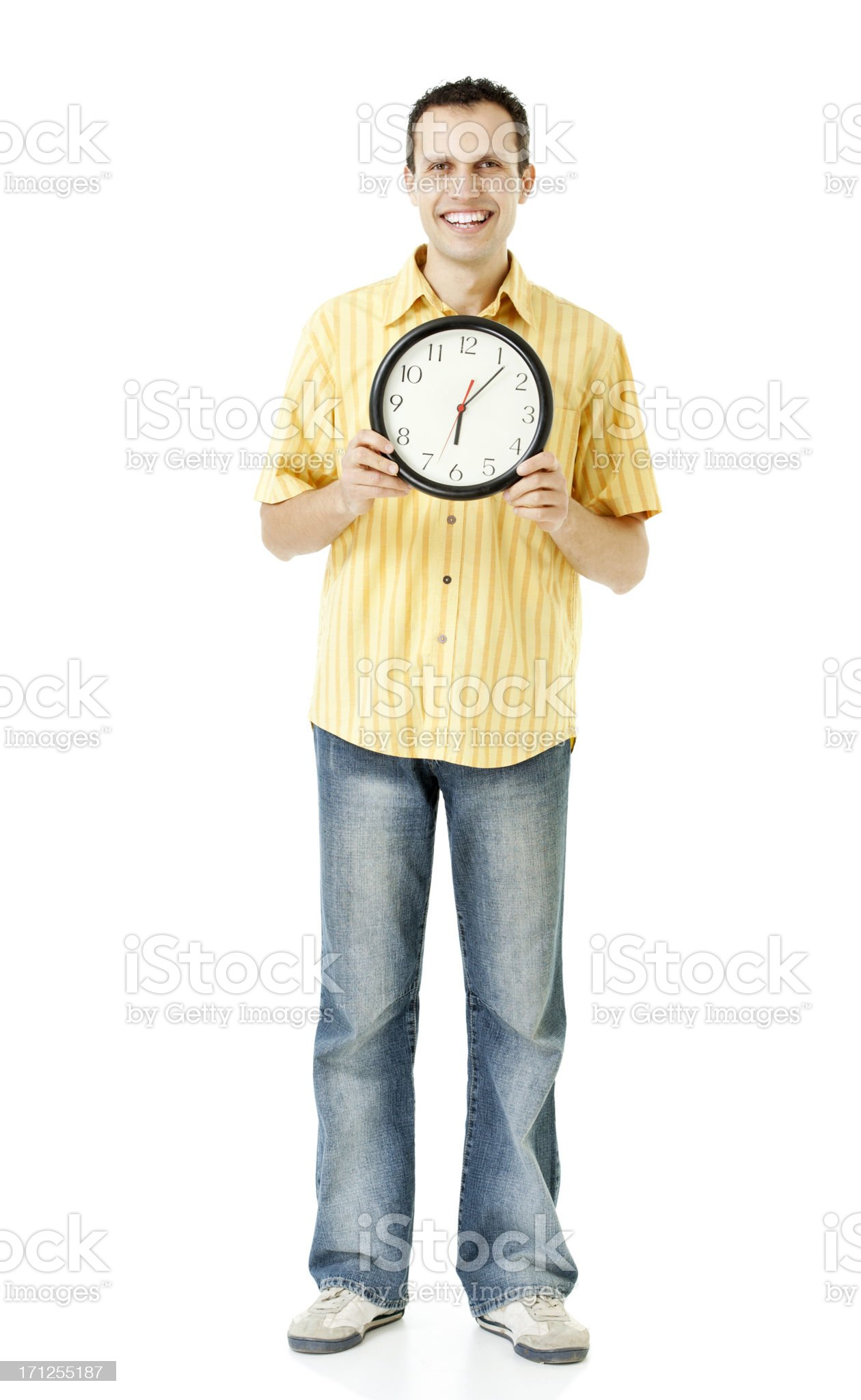 young man holding clock royalty-free stock photo