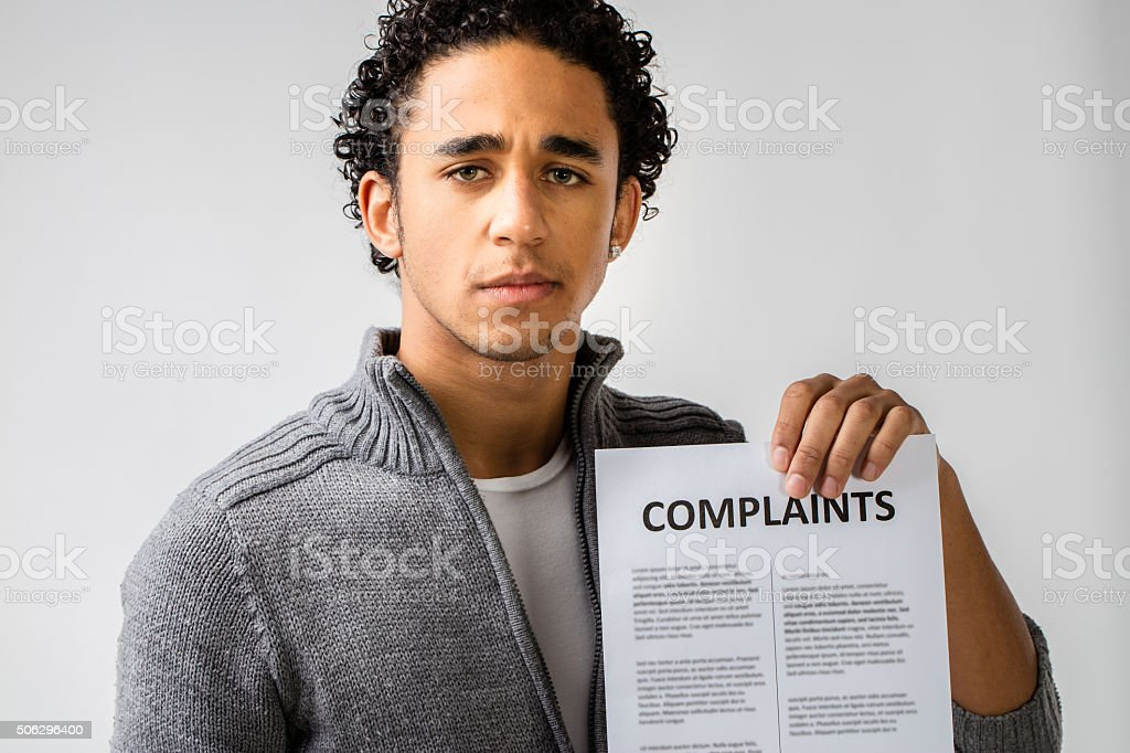 young man holding complaints report stock photo