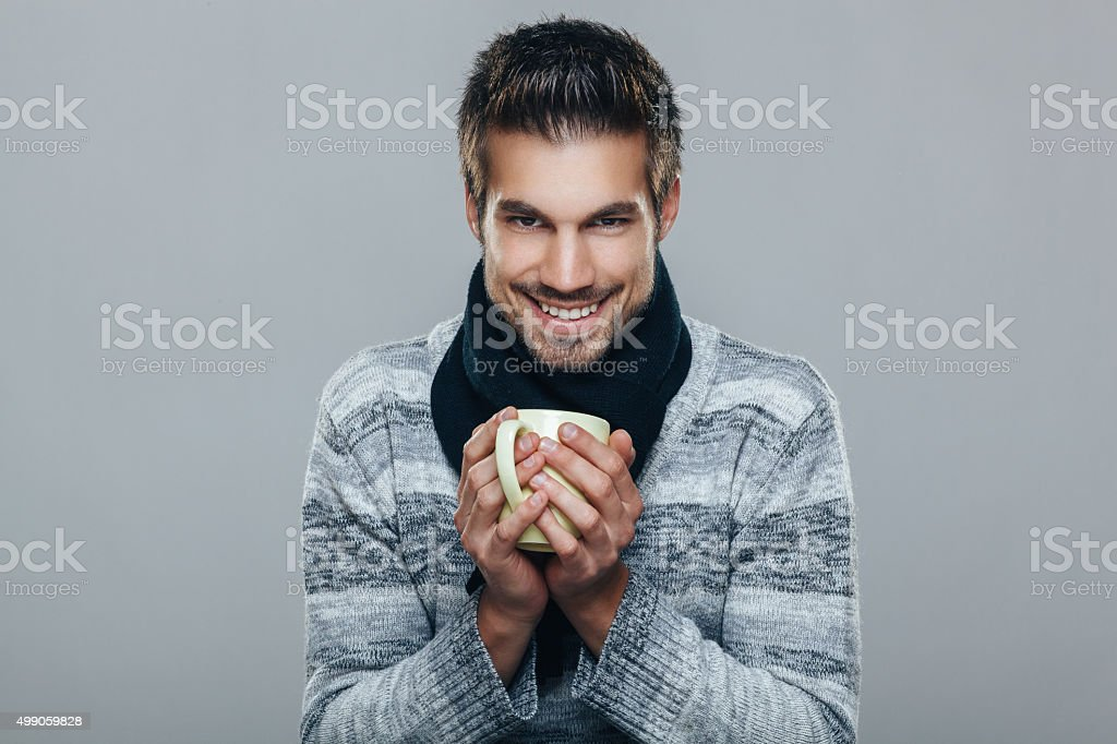 Young man holding cup of tea stock photo