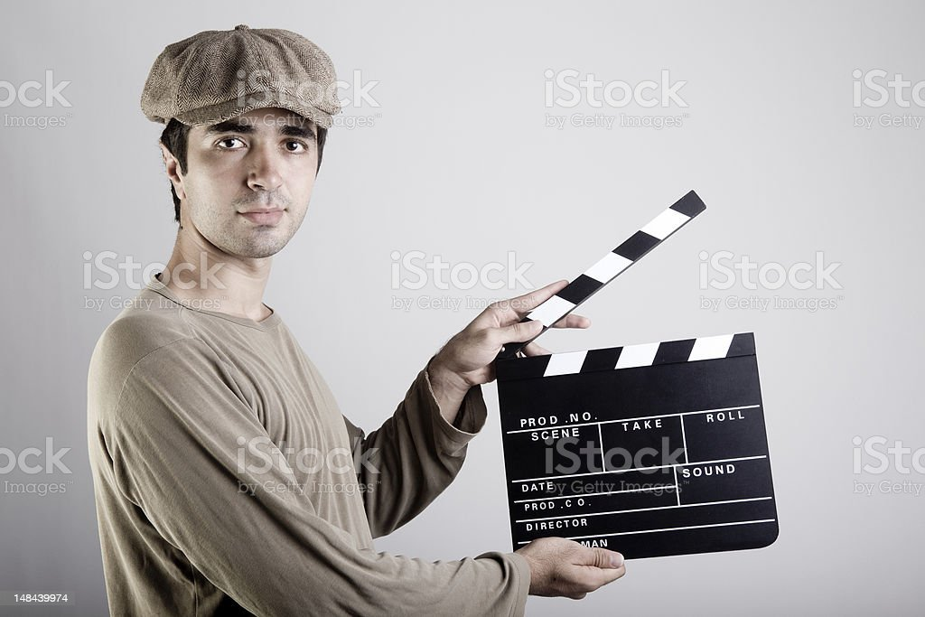 Young man holding film slate stock photo