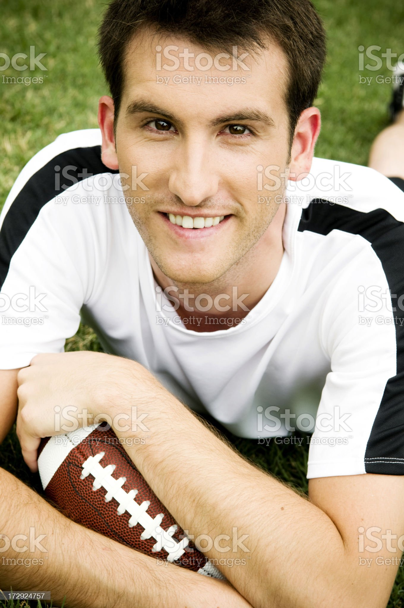 Young man holding football royalty-free stock photo
