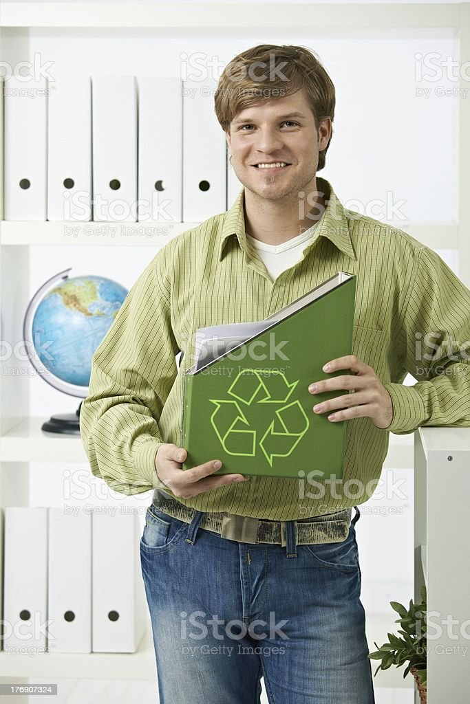 Young man holding green folder stock photo