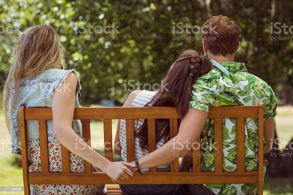 Young man holding hand of wrong girl stock photo