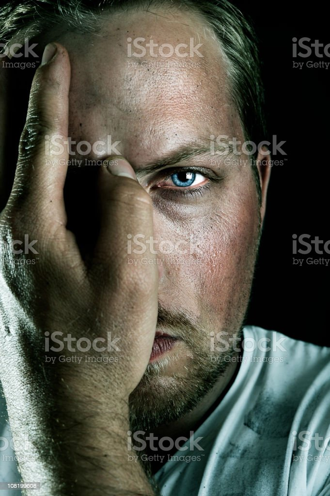 Young Man Holding Hand Over Eye stock photo