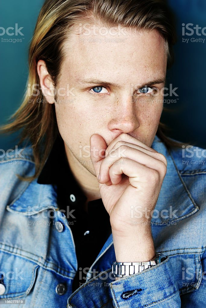 Young Man Holding Hand to Mouth royalty-free stock photo