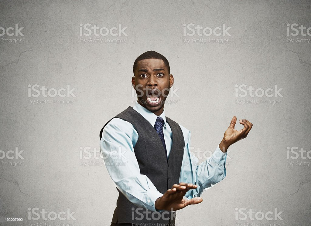 Young Man Holding His Hands Out In Fear stock photo