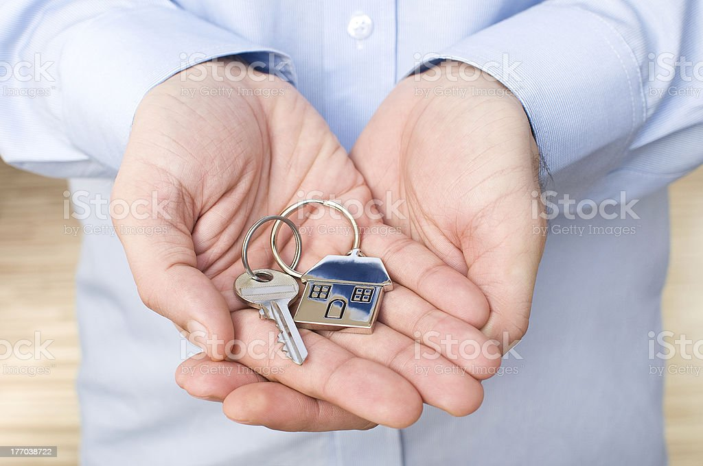 young man  holding key royalty-free stock photo