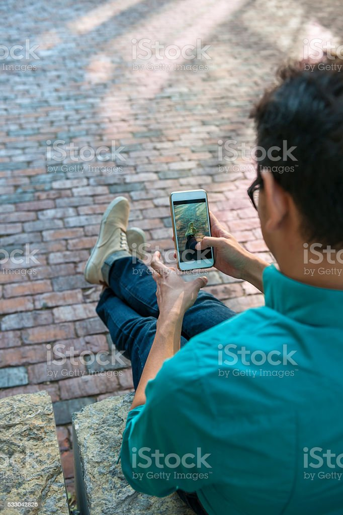 Young man holding mobile phone stock photo