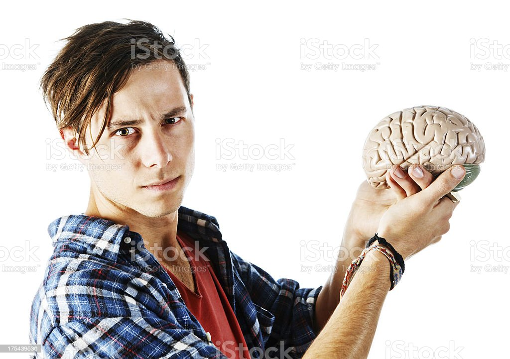 Young man holding model brain looks worried royalty-free stock photo