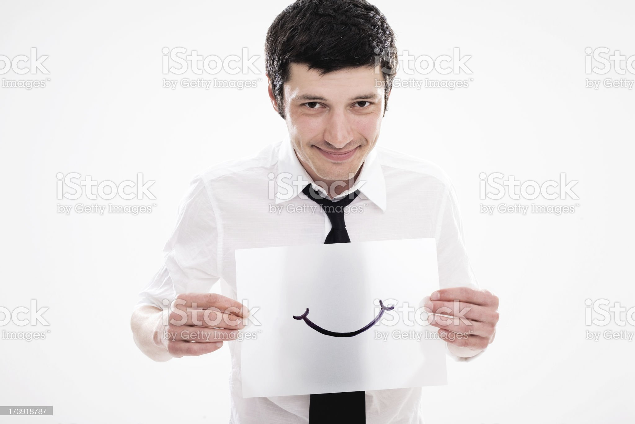 Young Man Holding Out A Smile royalty-free stock photo