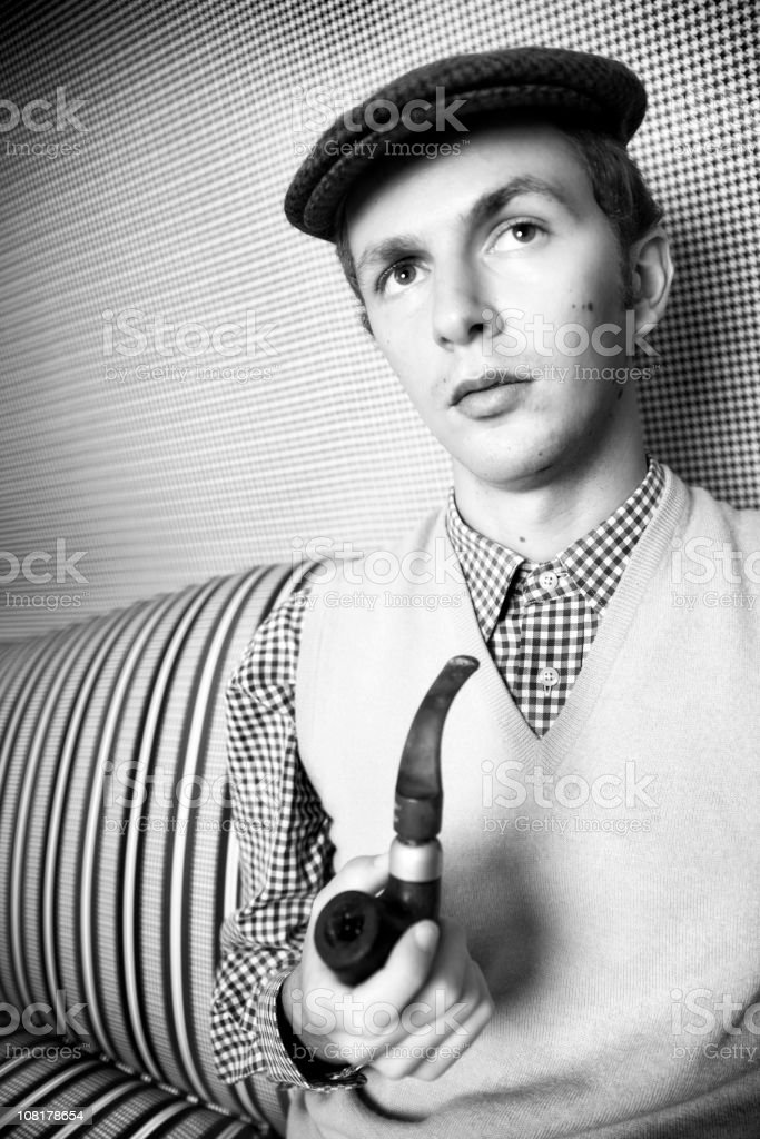 Young Man Holding Pipe, Black and White stock photo