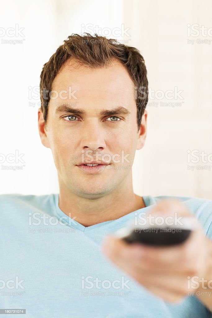 Young Man Holding Remote Control royalty-free stock photo