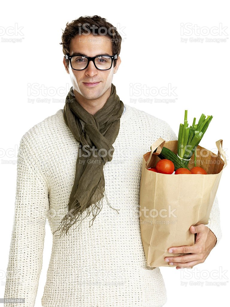 Young man holding shopping bag full of groceries royalty-free stock photo