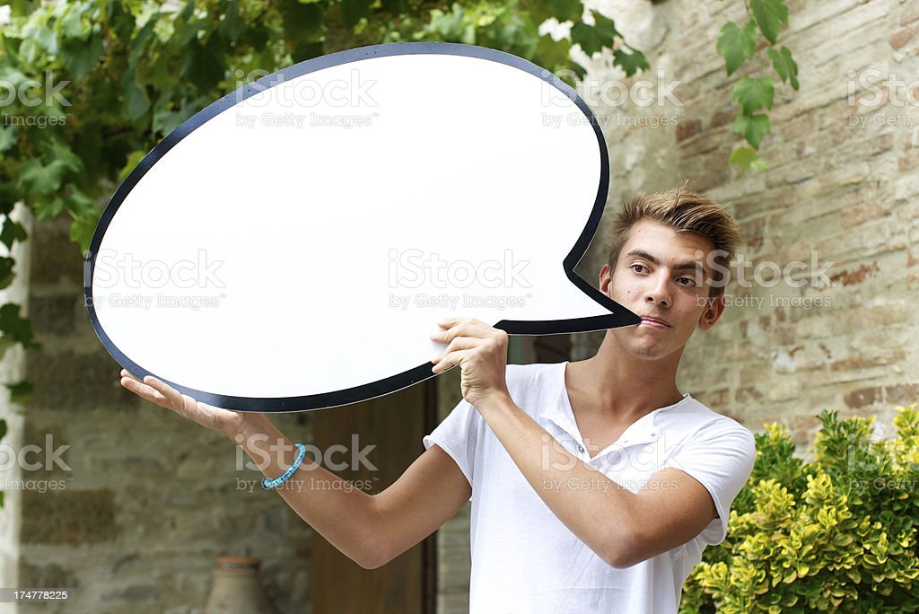 Young man holding speech bubble royalty-free stock photo