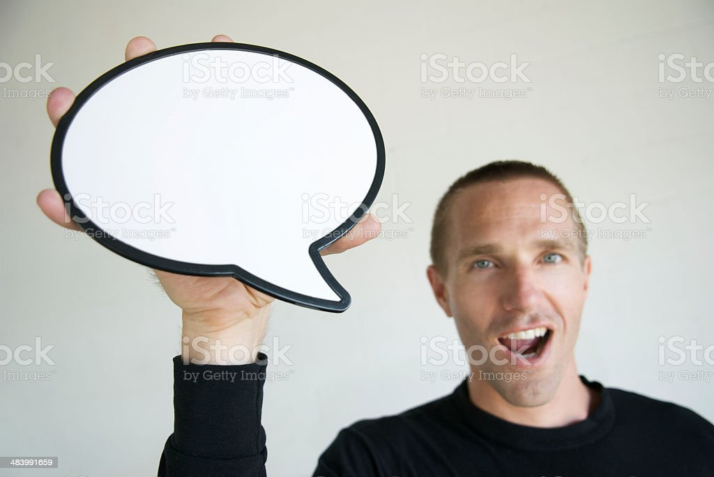 Young Man Holding Speech Bubble Talking White Background royalty-free stock photo