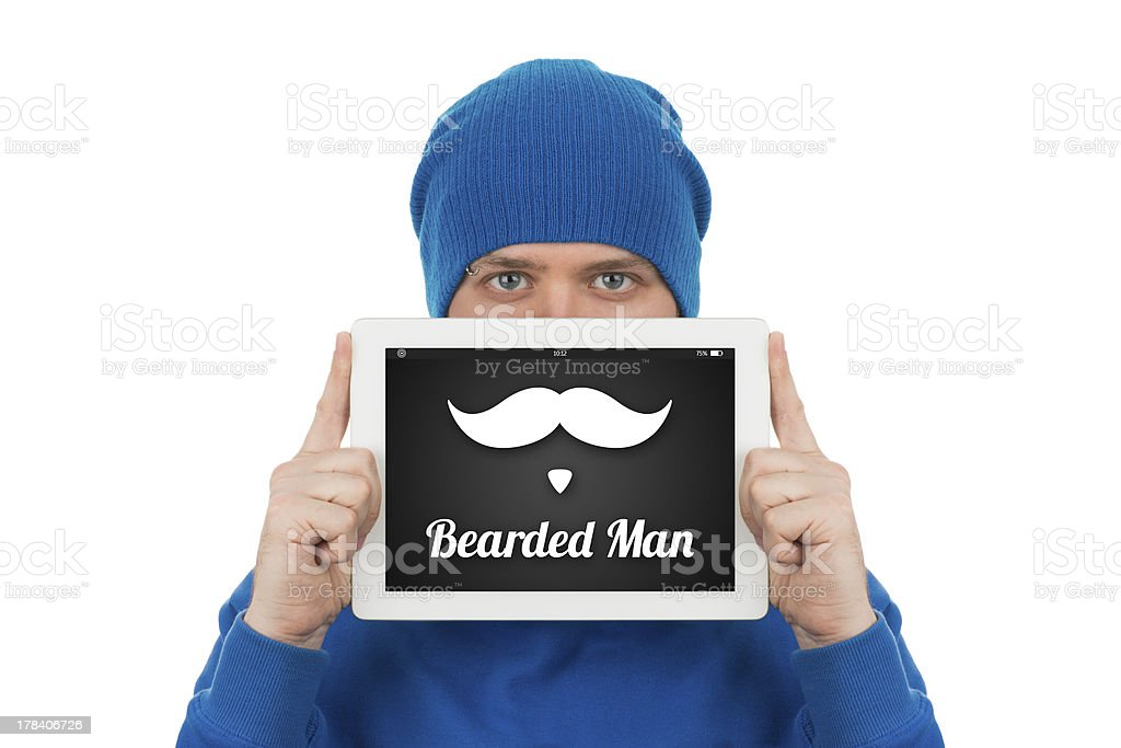 Young man holding tablet computer in front of his face. stock photo