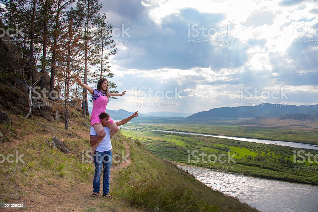 young man holding the girl on a neck stock photo