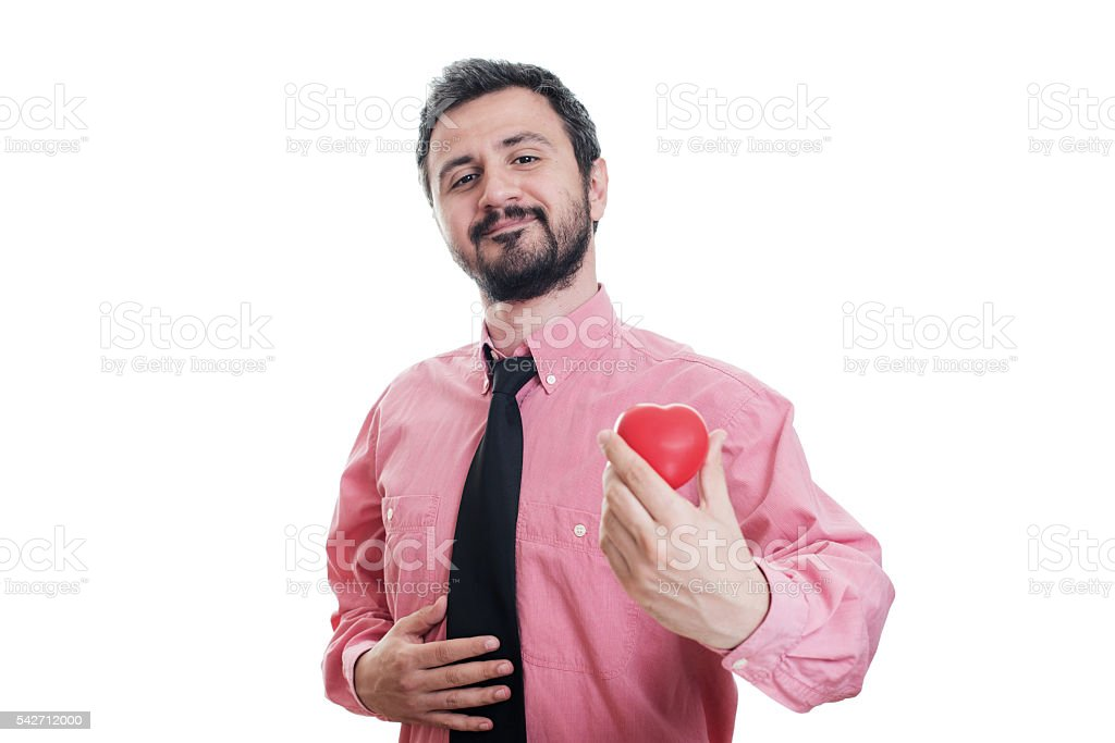 Young man holding the shape of a red heart stock photo