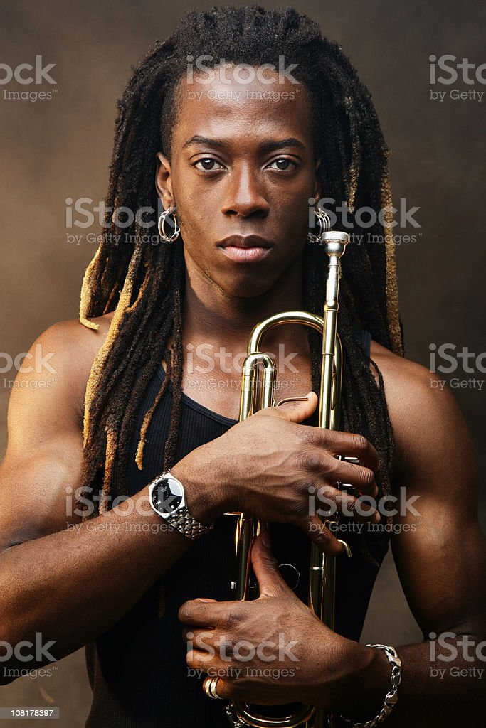 Young Man Holding Trumpet royalty-free stock photo