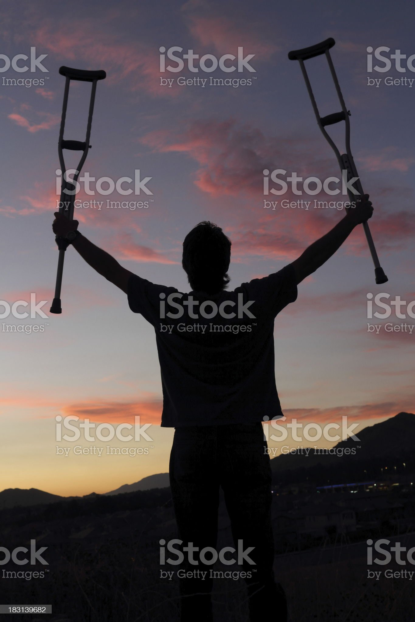 Young Man Holds Crutches in the Air royalty-free stock photo