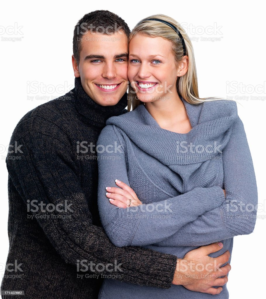 Young man hugging his girlfriend on white background royalty-free stock photo